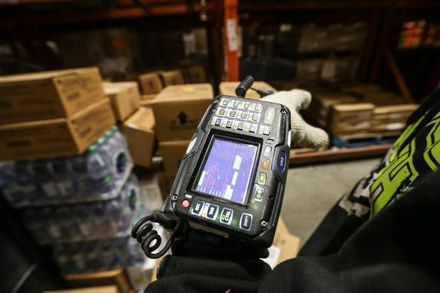 Flanagan's e-commerce market also helps differentiate the company from its competition, according to Odegi's Mr. Mr. Reyes. Here, pickers use scanners to help track down the correct product for the correct restaurant inside Flanagan's warehouse distribution centre in Kitchener, Ont.
