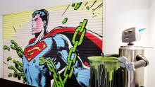 A garage door featuring Superman closes off the Superman inspired boardroom at the offices of DDB Canada, an integrated advertising agency located in Toronto. The robot is used as the company beer cart.
